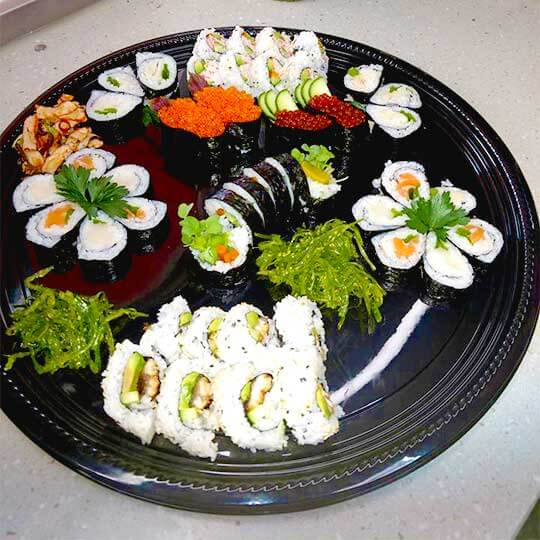 Large sushi platter for take-out or delivery.